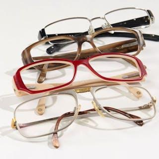 CHANEL, Deux paires de montures de lunettes. PRADA, Une paire de monture 899a877746fd